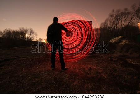 "Series of pictures ""Parallel reality"".Photo on a long exposure with the light source , the light circle. Photos in style picture light"