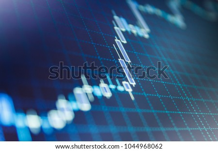 Display of quotes pricing graph visualization.  Financial statistic analysis on dark background with growing financial charts. Stock analyzing. Price chart bars.  Royalty-Free Stock Photo #1044968062