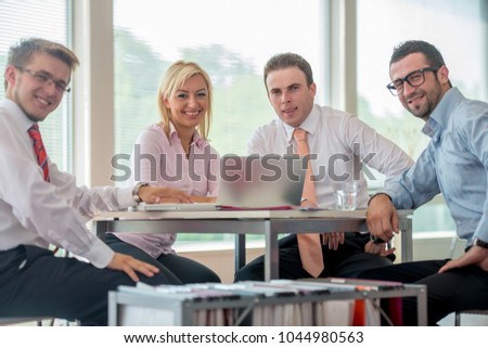 Group of business people discussing at meeting #1044980563