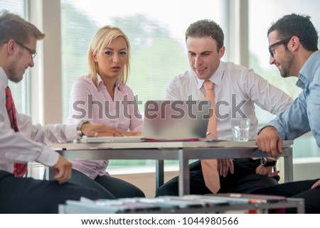 Group of business people discussing at meeting #1044980566