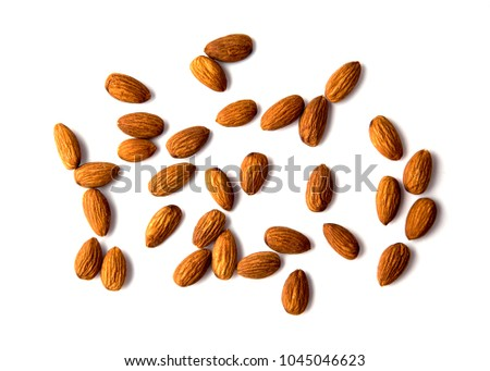 Raw Natural Organic Almonds Nuts Scattered Isolated on White Background Top View Healthy Food for Life Natural Light Selective Focus #1045046623