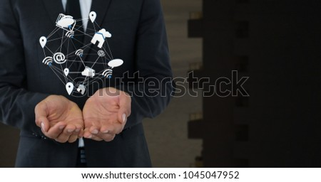 Digital composite of Mixed various app icons connected and Businessman with hands palm open and dark background #1045047952