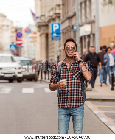 Hipster talking on mobile phone #1045048930