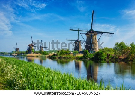 Netherlands rural lanscape with windmills at famous tourist site Kinderdijk in Holland #1045099627