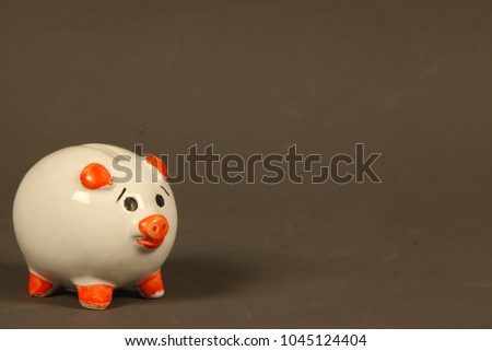 Piggy Bank and coins, savings is a good habit #1045124404
