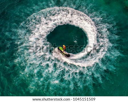 People are playing jet ski at sea during the holidays.  #1045151509