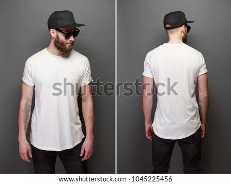 Hipster handsome male model with beard wearing white blank t-shirt with space for your logo or design over gray background #1045225456