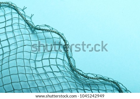 Fishing net with space for your text.  Royalty-Free Stock Photo #1045242949