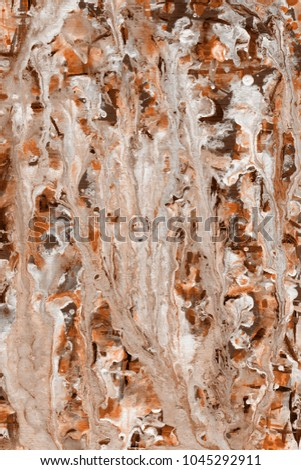 Orange wet abstract paint leaks and splashes texture on white watercolor paper background. Natural organic shapes and design. #1045292911