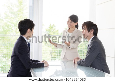 asian business team meeting in office #1045364083