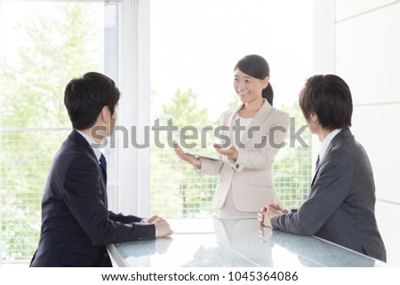 asian business team meeeting in office #1045364086