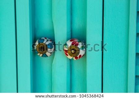 Tropical door handle. Brazilian beach vacations. #1045368424