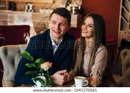 Happy young couple taking selfie with smart phone at cafe #1045370065