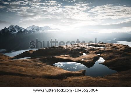 Lake Koruldi near Mt. Ushba. Location Upper Svaneti, Georgia country, Europe. Main Caucasian ridge. Scenic image of beautiful nature landscape, amazing mountain view. Explore the beauty of earth.