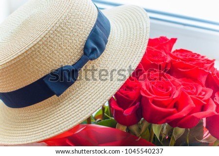 Hat of a boater and roses around, a stylish image detail for a women's fashion #1045540237