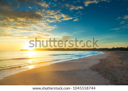 Colorful sunset over ocean on tropical island #1045558744