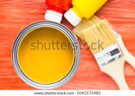 House renovation, paint cans and paintbrushes on the old wooden background top view #1045575985