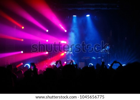 KYIV; UKRAINE-9 MARCH; 2018:Music hall concert.Electronic music festival in night club.Live set of Ukrainian indie band Yuko in nightclub Atlas.Red & blue stage lights #1045656775