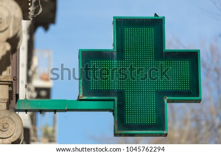 Closeup of an old, green pharmacy sign outside a pharmacy store in France. #1045762294