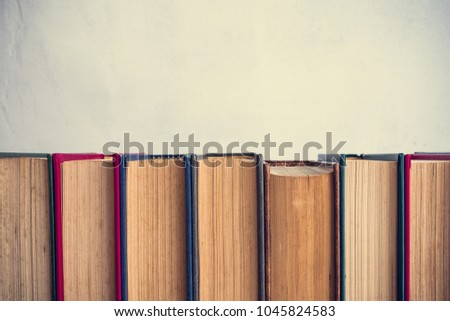 Old books on white wall background - Education concept, vintage tone #1045824583