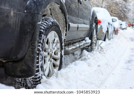 Parked cars covered with snow #1045853923