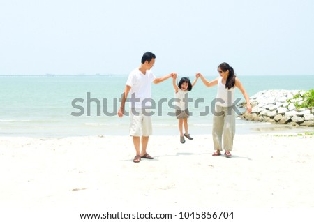 Happy family having fun at beach during summer day #1045856704