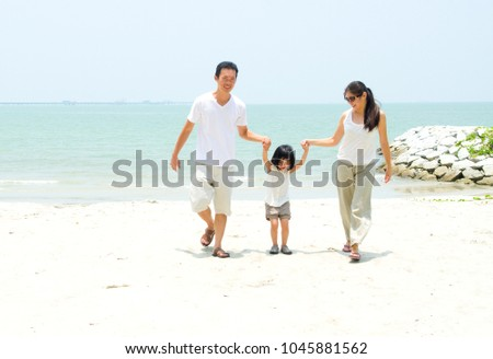Happy family having fun at beach during summer day #1045881562