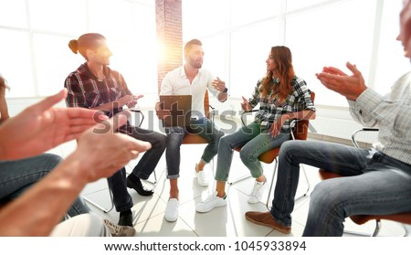 creative team applauding the coach Royalty-Free Stock Photo #1045933894