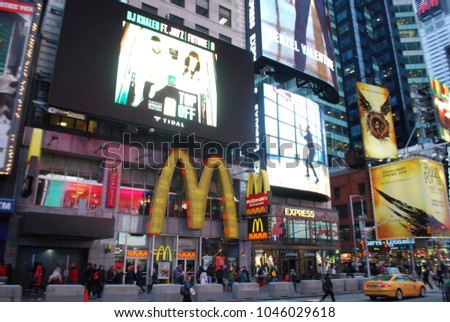 NEW YORK, USA - MARCH 10, 2018: Famous McDonalds Restaurant In Times Sqaure. More than 300,000 people pass through Times Square daily. Famous Corporation, Fast Food, Friends, Burger, Drinks, Logo #1046029618