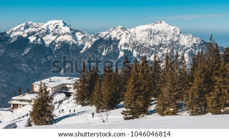 Beautiful alpine winter landscape view with orange teal look #1046046814