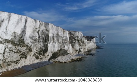 Aerial photo of famous White Cliffs of Dover they are cliffs that form part of English coastline facing Strait of Dover and France these are part of the North Downs formation #1046068639