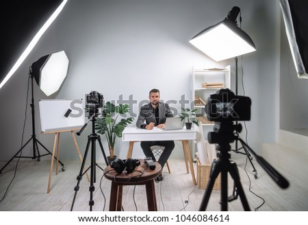 Video footage of the training program from a young business coach. Backstage recording video of a business lecture. Royalty-Free Stock Photo #1046084614