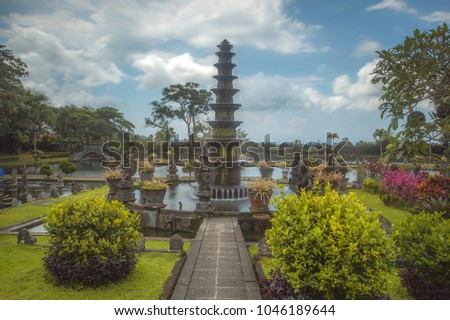 Ujung Water Palace is a former palace in Karangasem Regency, Bali. The palace three large pools. In the middle of the pool, there is the main building connected by bridge. 02 March 2018 #1046189644
