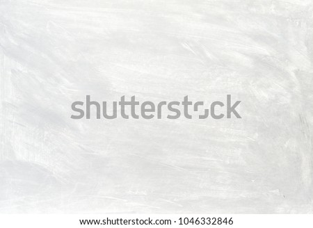 White washed painted textured abstract background with brush strokes in gray and black shades. #1046332846