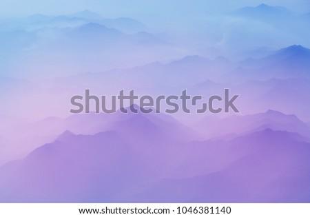 Serenity scene  Mountain silhouette Royalty-Free Stock Photo #1046381140
