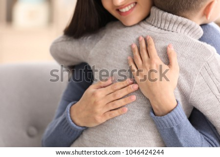 Woman hugging little boy indoors. Child adoption #1046424244