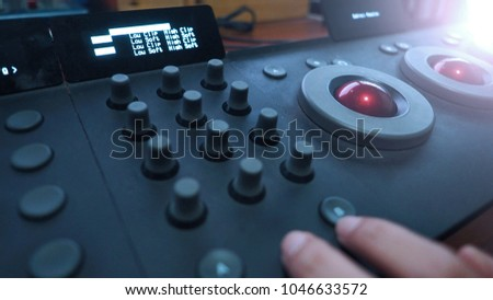 Color grading adjusting controller equipment for editing film or movie colortone in telecine lab post production stage.