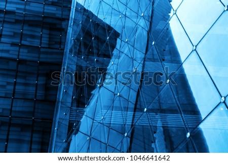 Geometric structure glass windows in skyscrapers #1046641642