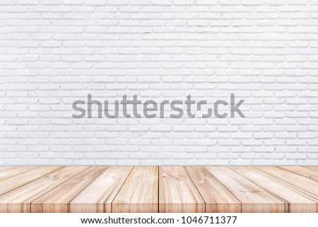 Empty wooden table top with white color brick wall background. can be used product display.  #1046711377