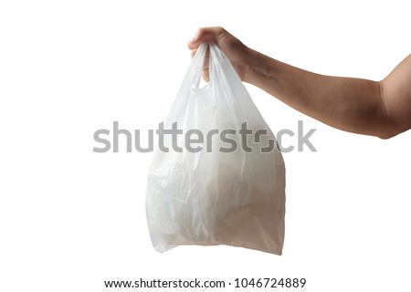 Hand holding white plastic bag of garbage isolated on white background #1046724889