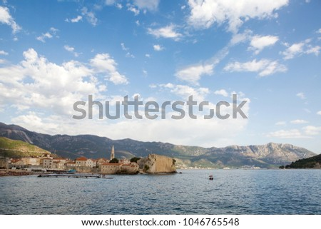 Budva, Montenegro - September 17: old town in Budva view of the promenade with houses in the European day of languages on September 17, 2017 #1046765548