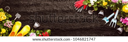 Gardening Tools on Soil Background. Spring Garden Works Concept #1046821747