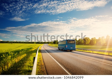 Bus on asphalt road in beautiful spring day at countryside #1046842099