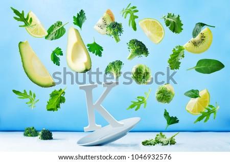 Flying foods rich in vitamin k. Green vegetables. Healthy eating #1046932576