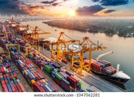 Logistics and transportation of Container Cargo ship and Cargo plane with working crane bridge in shipyard at sunrise, logistic import export and transport industry background #1047062281