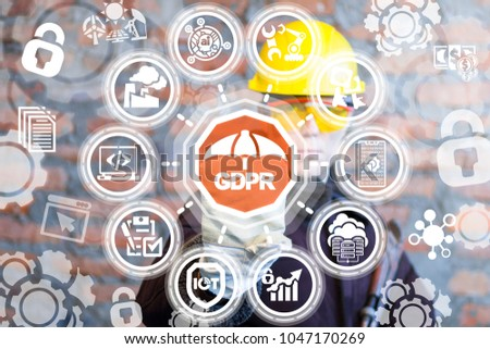 Industrial engineer pressing gdpr umbrella button on a virtual interface. General Data Protection Security Regulations Industry 4.0 Smart Manufacture concept.