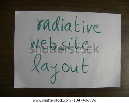 Text radiative website layout hand written by green oil pastel on white color paper #1047406996