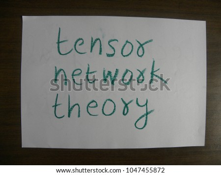 Text tensor network theory hand written by green oil pastel on white color paper #1047455872