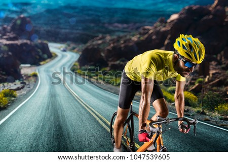 Professional road bicycle racer in action Royalty-Free Stock Photo #1047539605