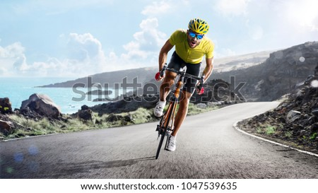 Professional road bicycle racer in action Royalty-Free Stock Photo #1047539635